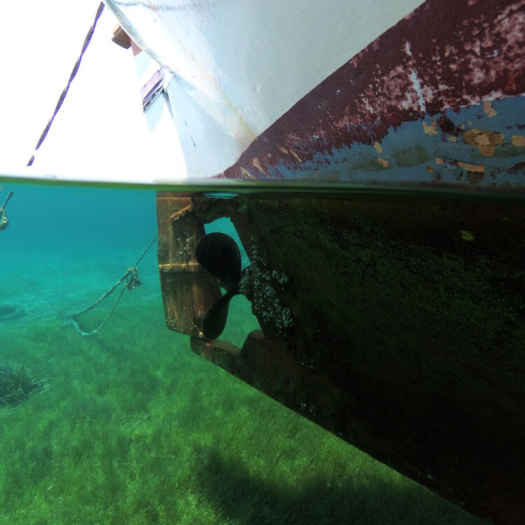 Boat with propeller under the waterline.