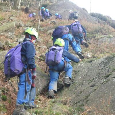 Children climbing a mountain
